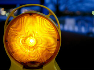 An orange warning light on a building site
